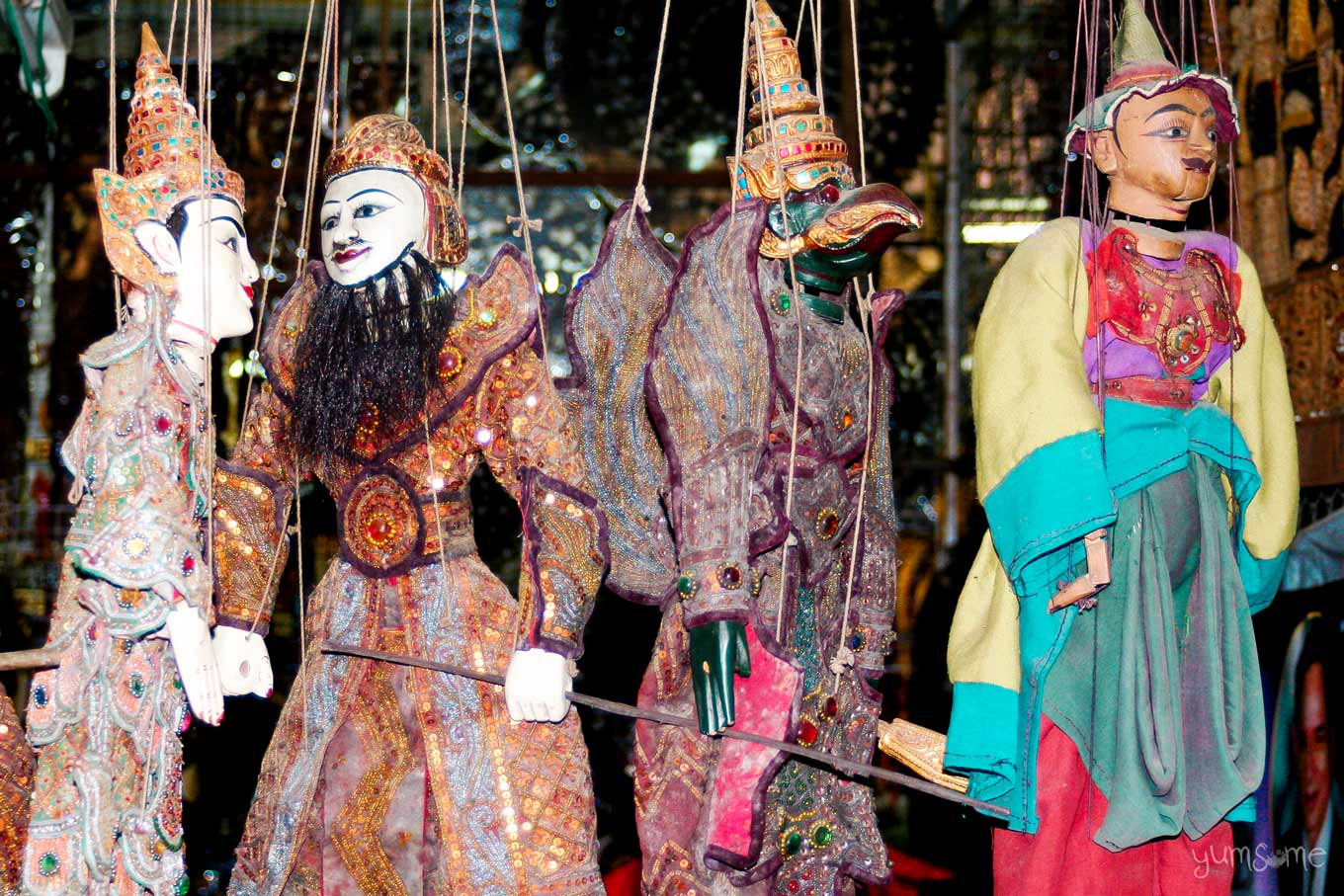 Four marionettes on a souvenir stall at the foot of Wat Doi Suthep.