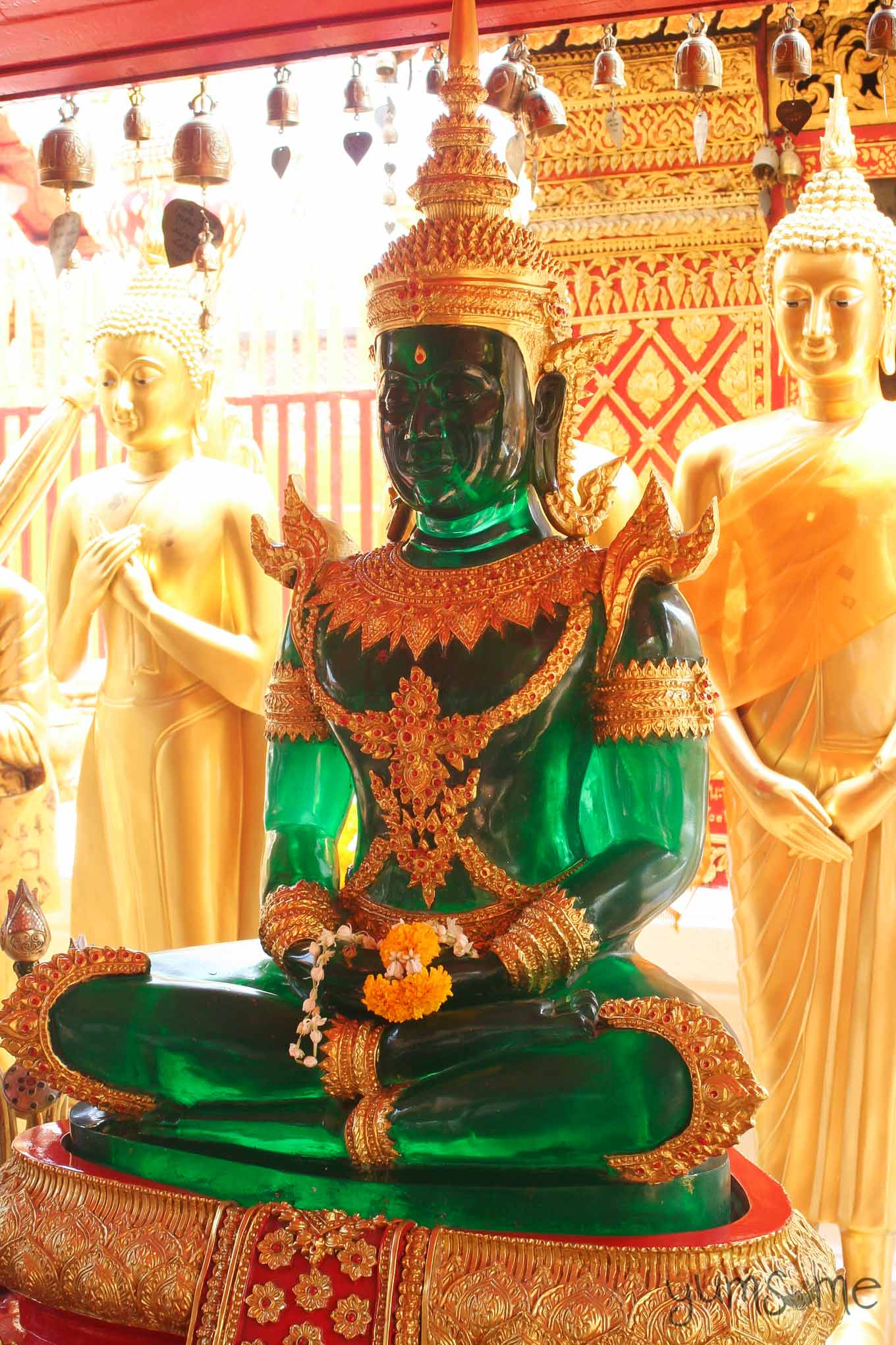 Emerald Buddha statue, seated in the meditation pose.