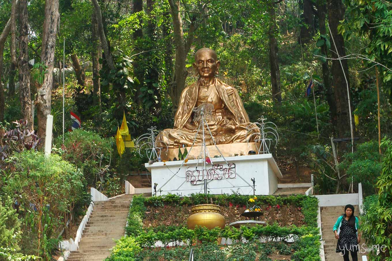 The Khruba Sri Vichai statue among the trees at Wat Doi Suthep.