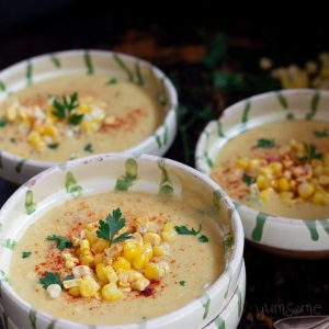 Several bowls of corn chowder.