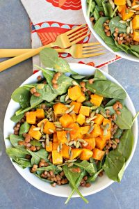A plate of roasted butternut squash salad.