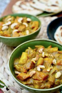 Two green bowls filled with pumpkin curry.