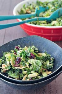 A grey dish full of brussels and kale chiffonade salad.