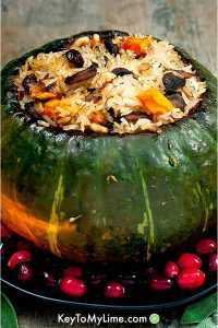 A roast kabocha squash filled with rice and vegetables.