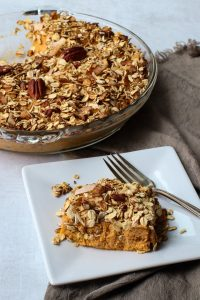 Vegan sweet potato casserole with granola topping.