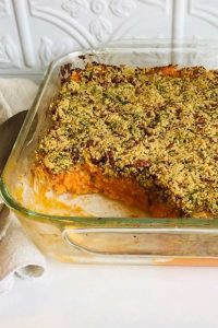 A glass oven dish of sweet potato casserole.