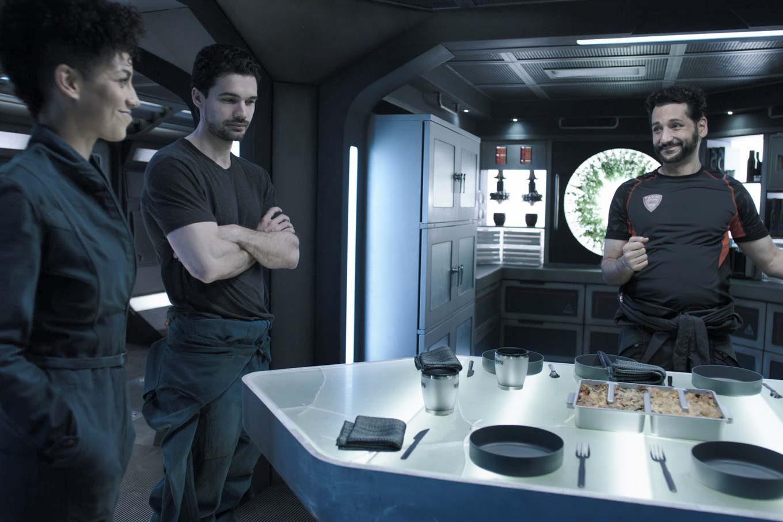 Alex unveils his Martian lasagna to Naomi and Holden.