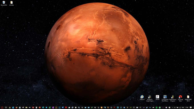 Desktop wallpaper image of an artist's rendition of Mars, showing Mariner Valley across the equator.