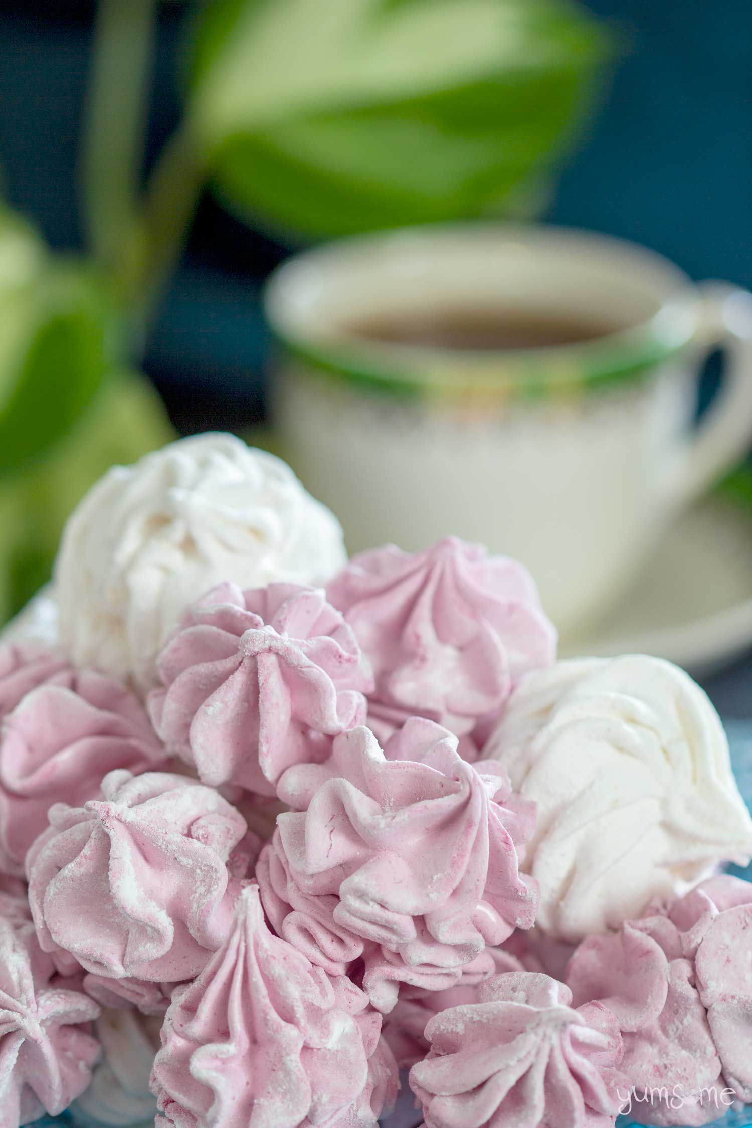 Pink and white vegan marshmallows and a cup of tea.